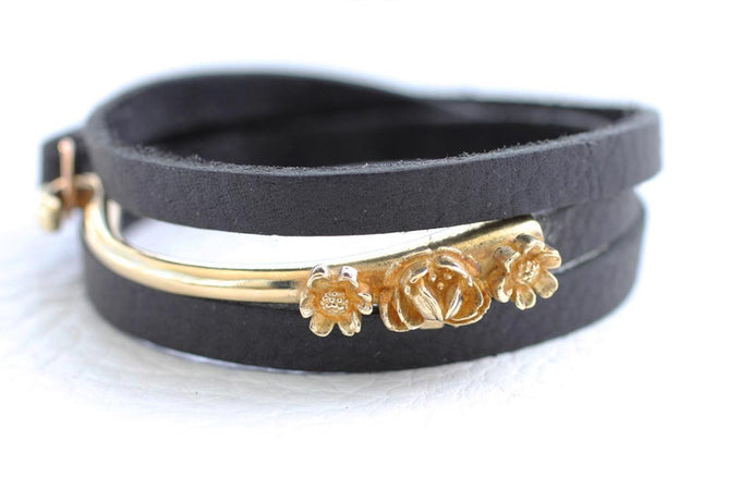 brass metal hook with flowers and black leather strap