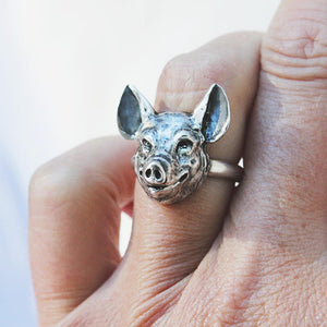 sterling silver ring with a pig face