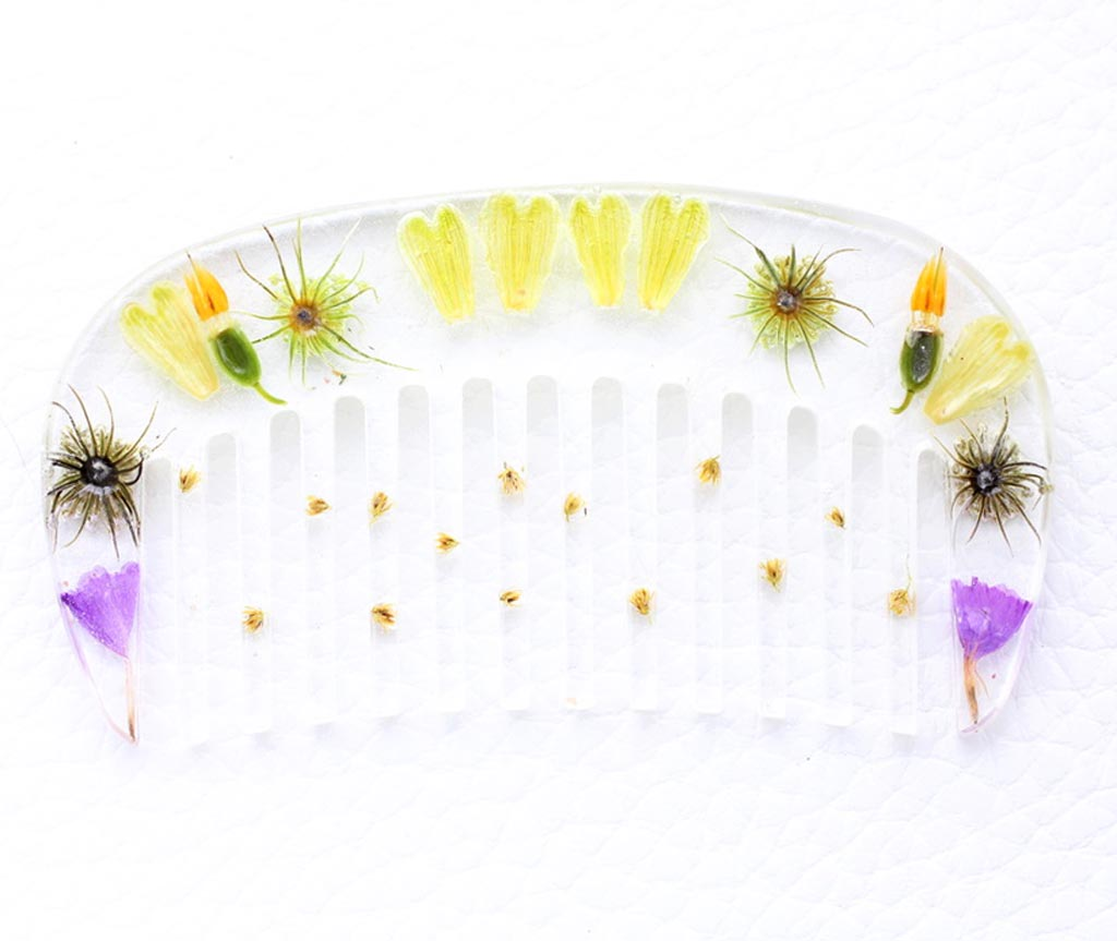 clear resin comb with wild flowers inside