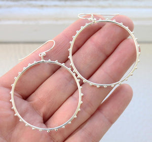 dangle circle hoops in sterling on hand