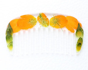 orange and green wild flowers in a resin hair comb