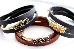 three leather bracelets with flowers in brown and black leather