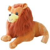 Lion en peluche allongé.