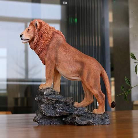 Statue lion design marron.