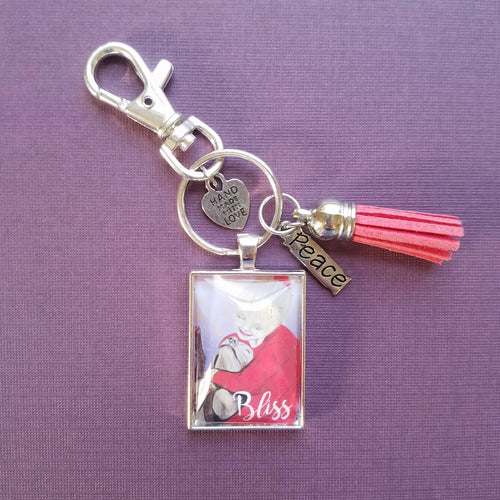 Bliss Girl and Dog Pendant Keychain with tassel of girl hugging her dog