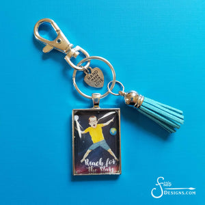 Reach for the Stars pendant keychain of boy jumping in space