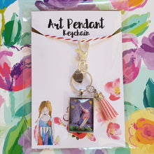 Load image into Gallery viewer, Reach for the Stars pendant keychain a girl reaching upward into the sky