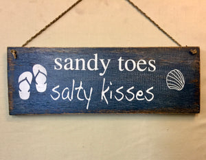Sign: Sandy Toes ...