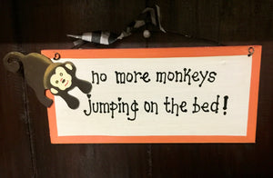 Sign: No more monkeys jumping on the bed !
