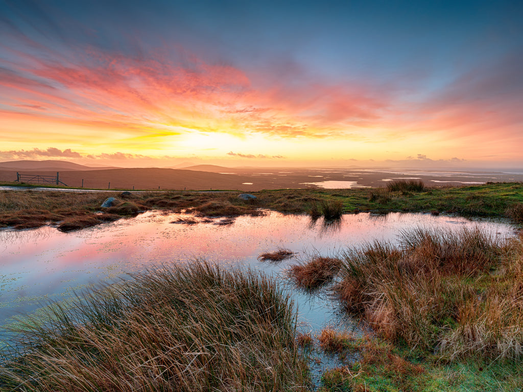 Beautiful sunrise over peat bogs in North Uist, Scotland.