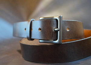 Our men's chestnut brown dress belt is made from full grain bridle leather.  It's the perfect ensemble for any special occasion.  Once you own a full grain leather belt, you will never go back.  Handmade in Austin, Texas!