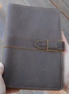 The Colorado leather journal Fits A5 Moleskine notebook Paper.  It features a strap closure and paper organizer.  Made from premium full grain leather.  Get it personalized and make the perfect gift.  Handmade in Austin, Texas!