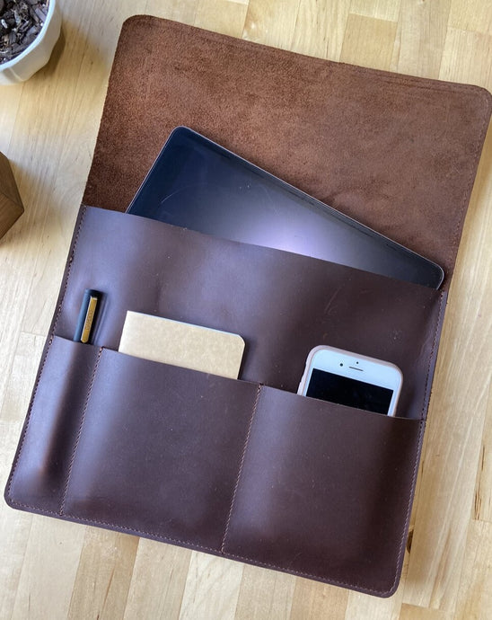 "This sleek full grain leather sleeve is made to fit tablets that are 12"" x 8.75"" x .5""   Extra pockets will carry your field notes and a phone up to 3"" wide.  Water resistant and Provides protection from minor falls.  Personalize it and complete the perfect gift!  Made in Austin, Texas"