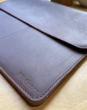 "Load image into Gallery viewer, This sleek full grain leather sleeve is made to fit tablets that are 12"" x 8.75"" x .5""   Extra pockets will carry your field notes and a phone up to 3"" wide.  Water resistant and Provides protection from minor falls.  Personalize it and complete the perfect gift!  Made in Austin, Texas"