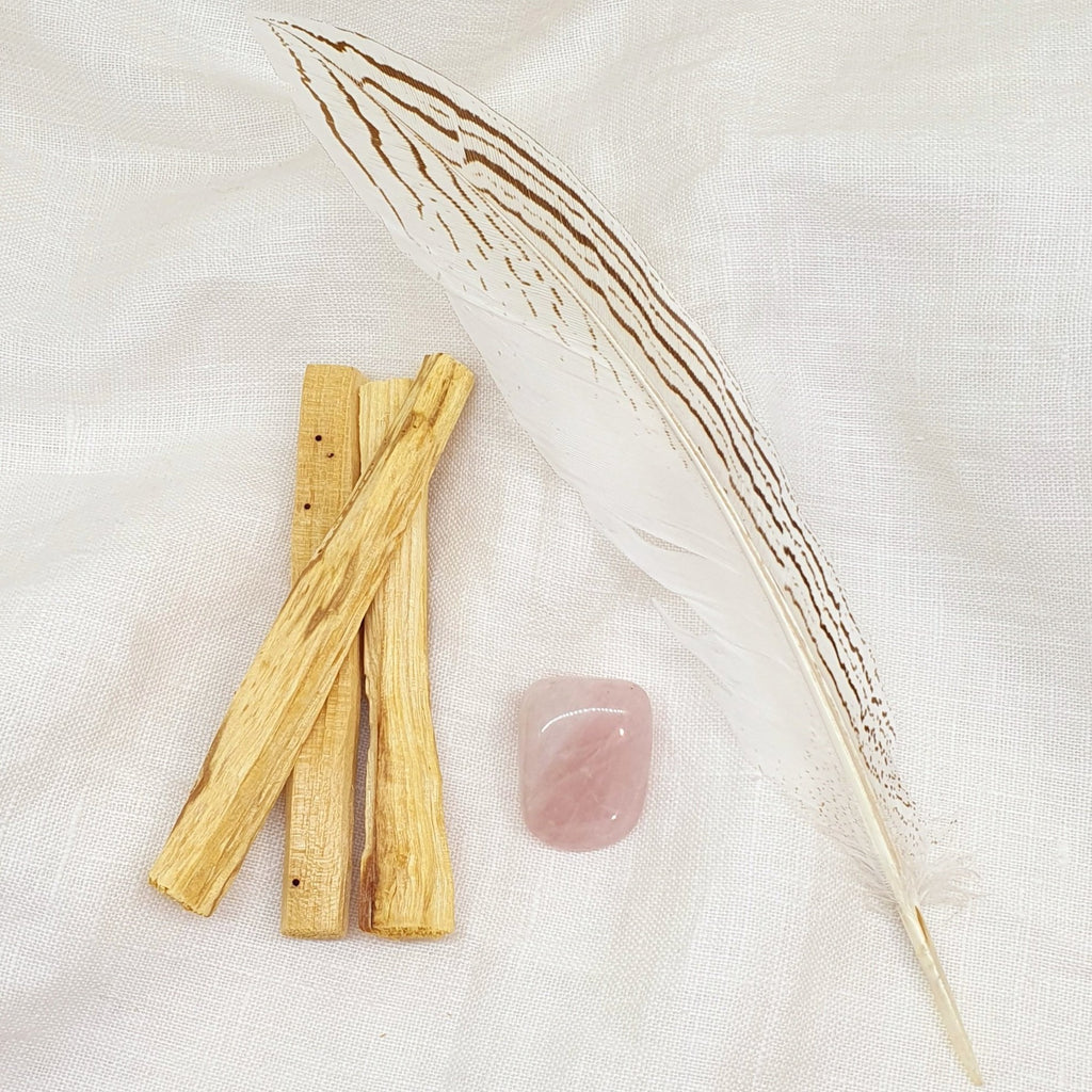 palo santo smudge kit with rose quartz and feather
