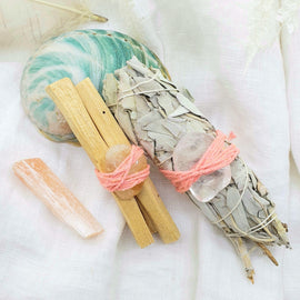 white sage and palo santo with crystals