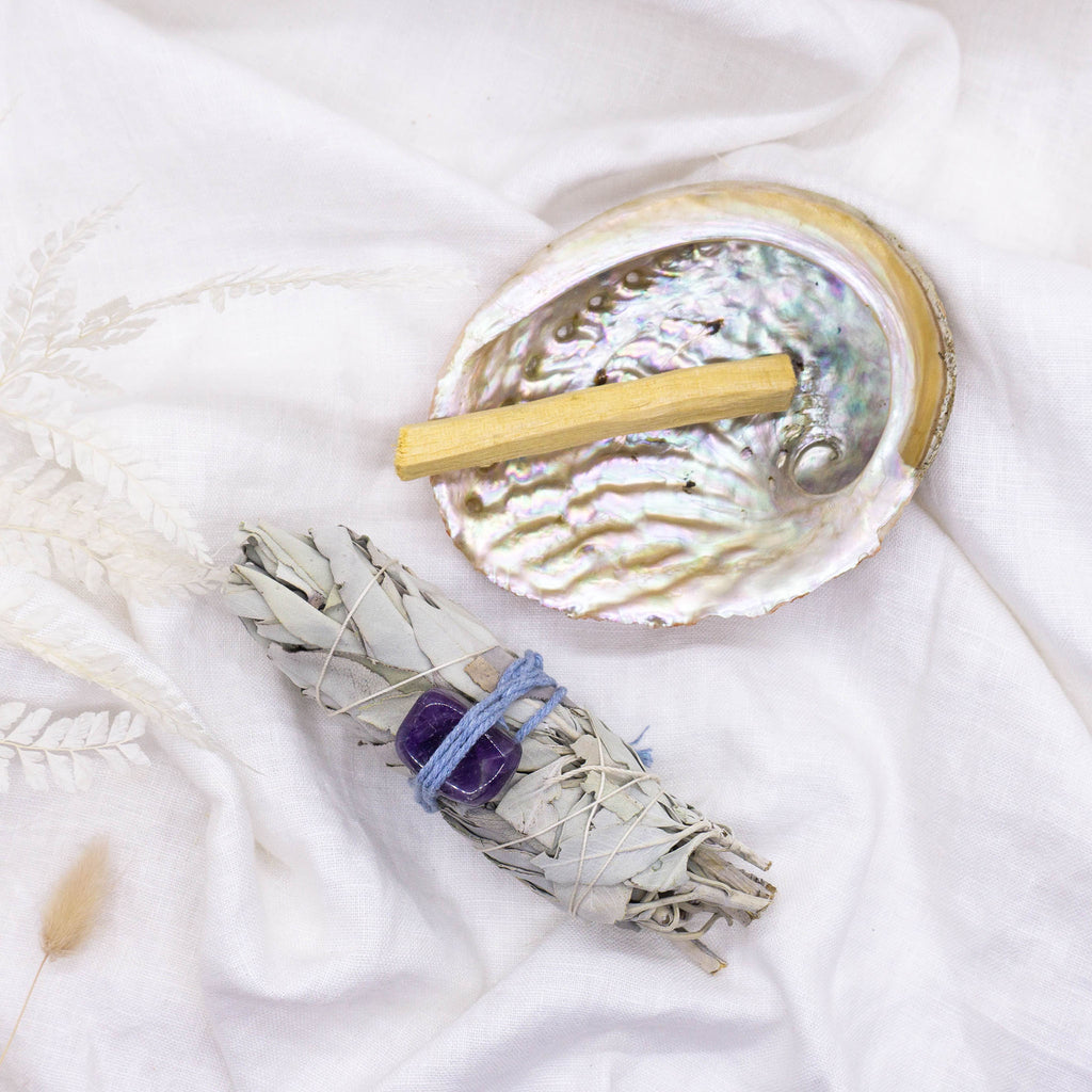 white sage and palo santo smudge sticks with Amethyst and Abalone Shell