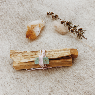 palo santo with green calcite and citrine crystal