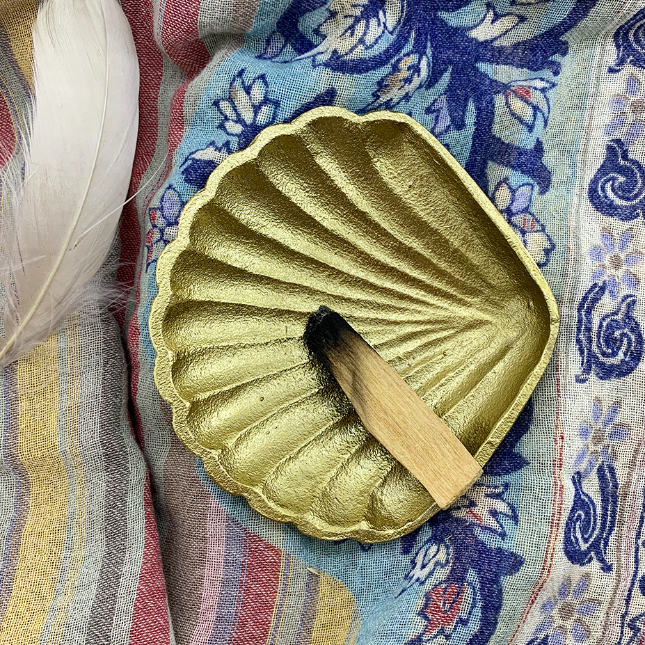 palo santo in smudging dish