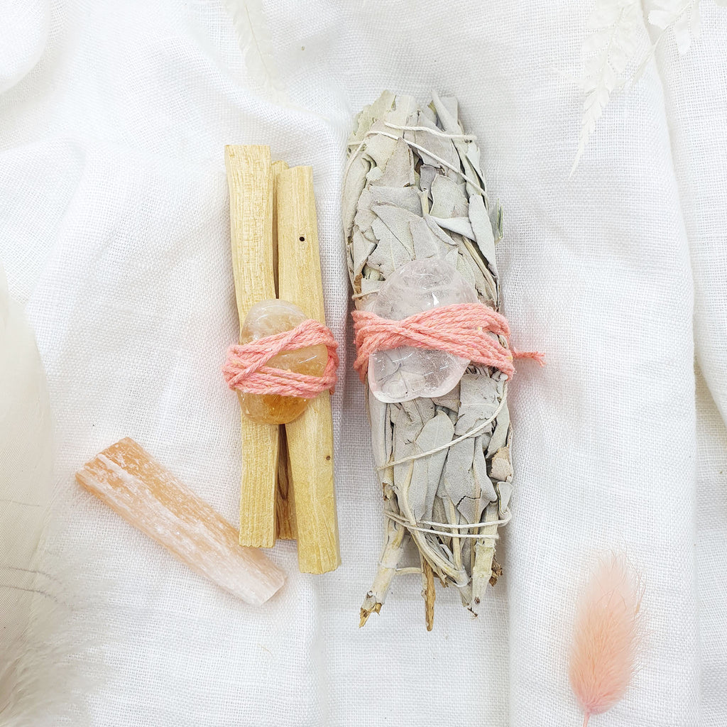 smudge stick kit with palo santo, white sage, peach selenite, citrine and quartz