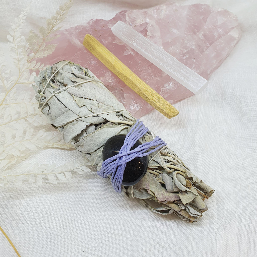 white sage with smoky quartz palo santo and selenite rod