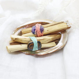palo santo smudge sticks with tiger's eye and amethyst gemstones