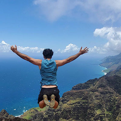 Allon jumping from cliff in Kauai. The Hawaiian Aloha lifestyle with Dr. Allon Amitai.