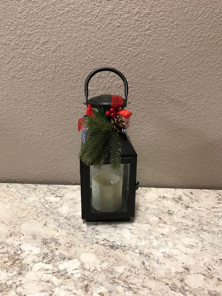 Metal Lantern with greenery and pinecones