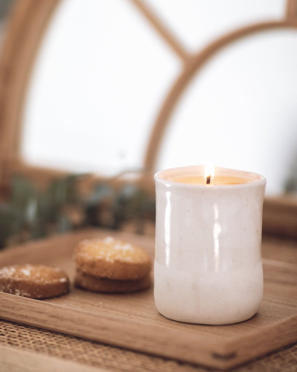 Gingerbread candle on a wooden tray with cookies