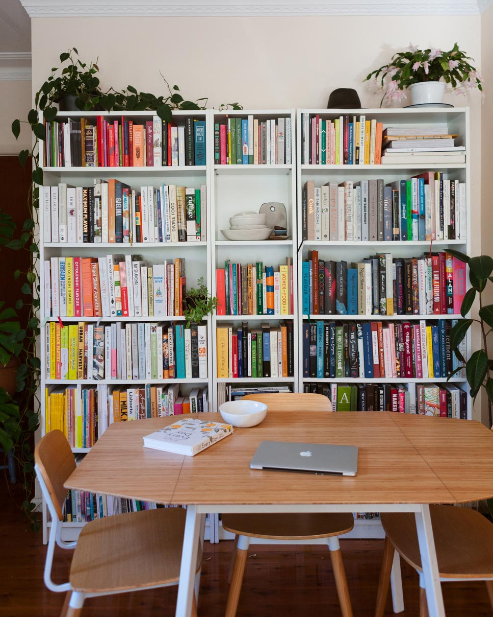 Luisa Brimble's bookcase housing her huge collection of cookbooks