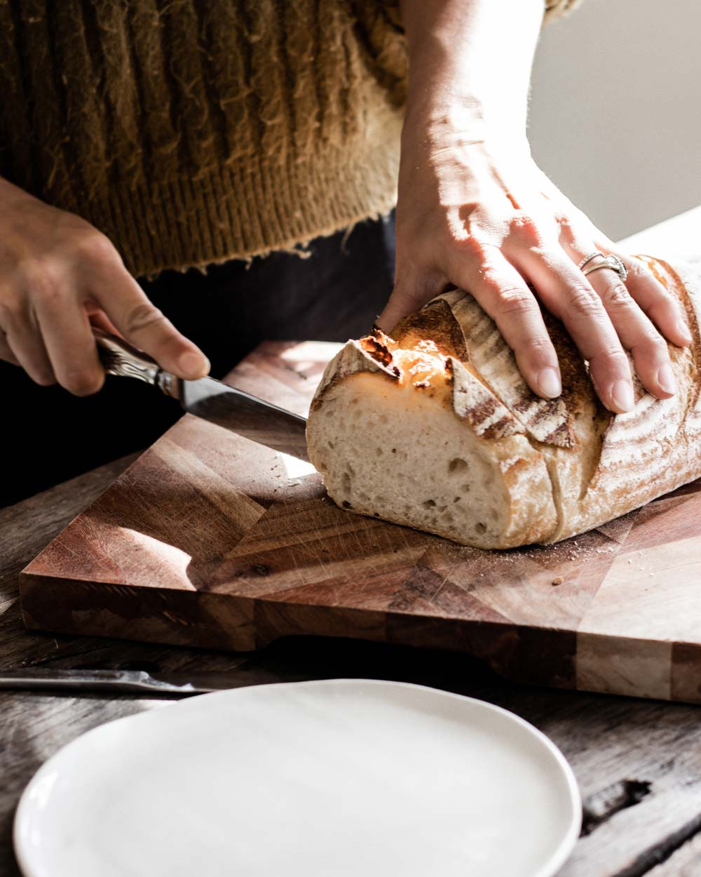 Cutting sourdough at the Slow Drift