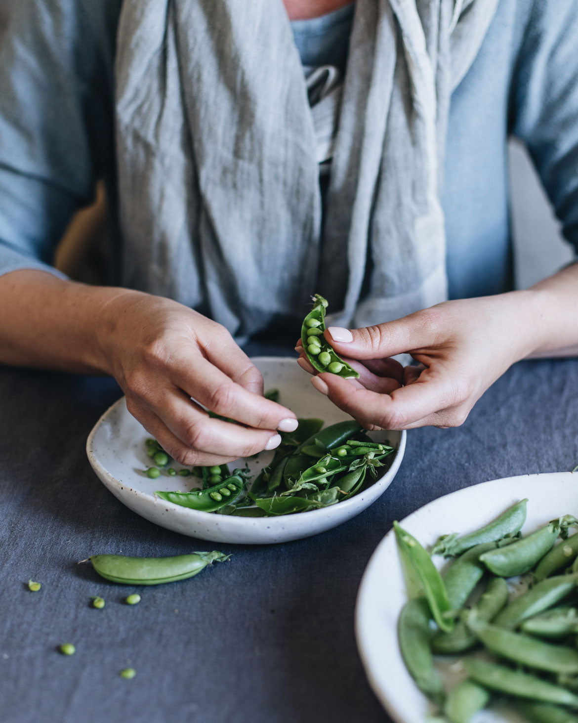 Shelling peas into a handmade bowl