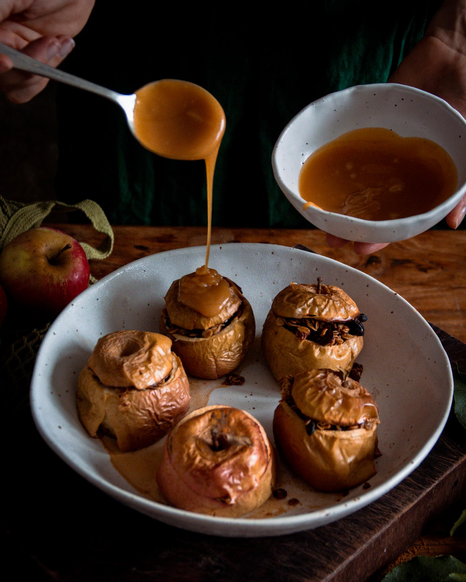 Apples baked in a Winterwares family bowl, with caramel sauce drizzled on top