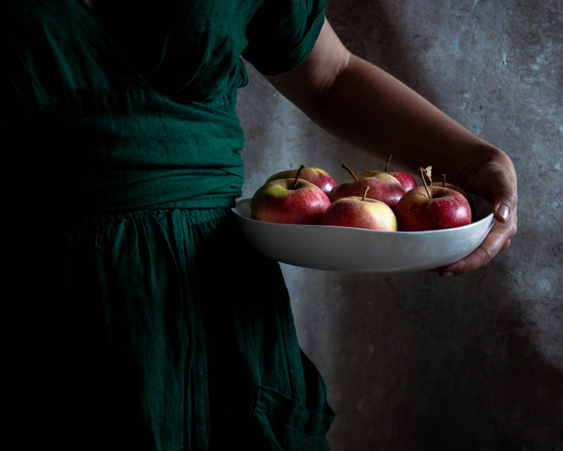 Holding a bowl of freshly picked apples