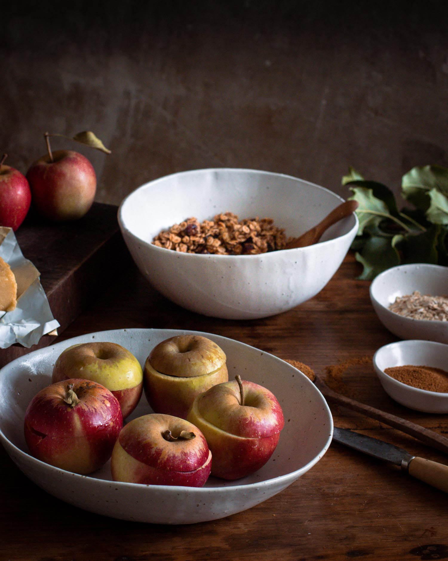 Bowl of apples ready to be filled with granola and baked in the oven.