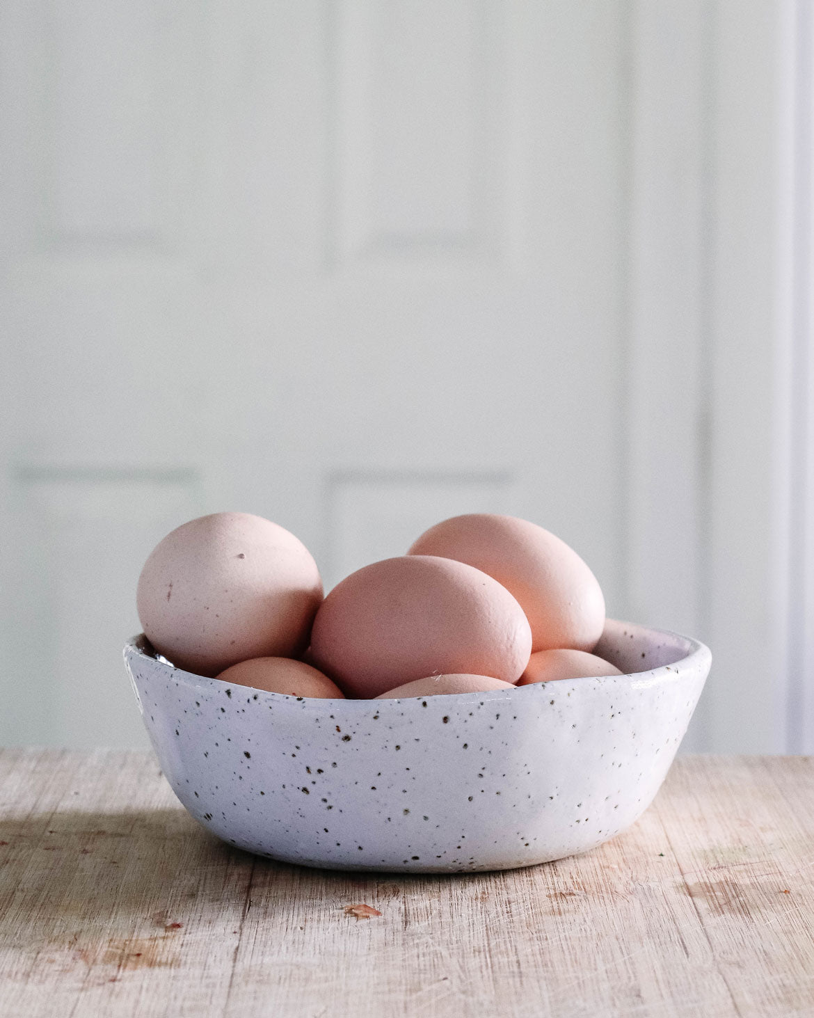 Fresh eggs in a handmade pottery bowl
