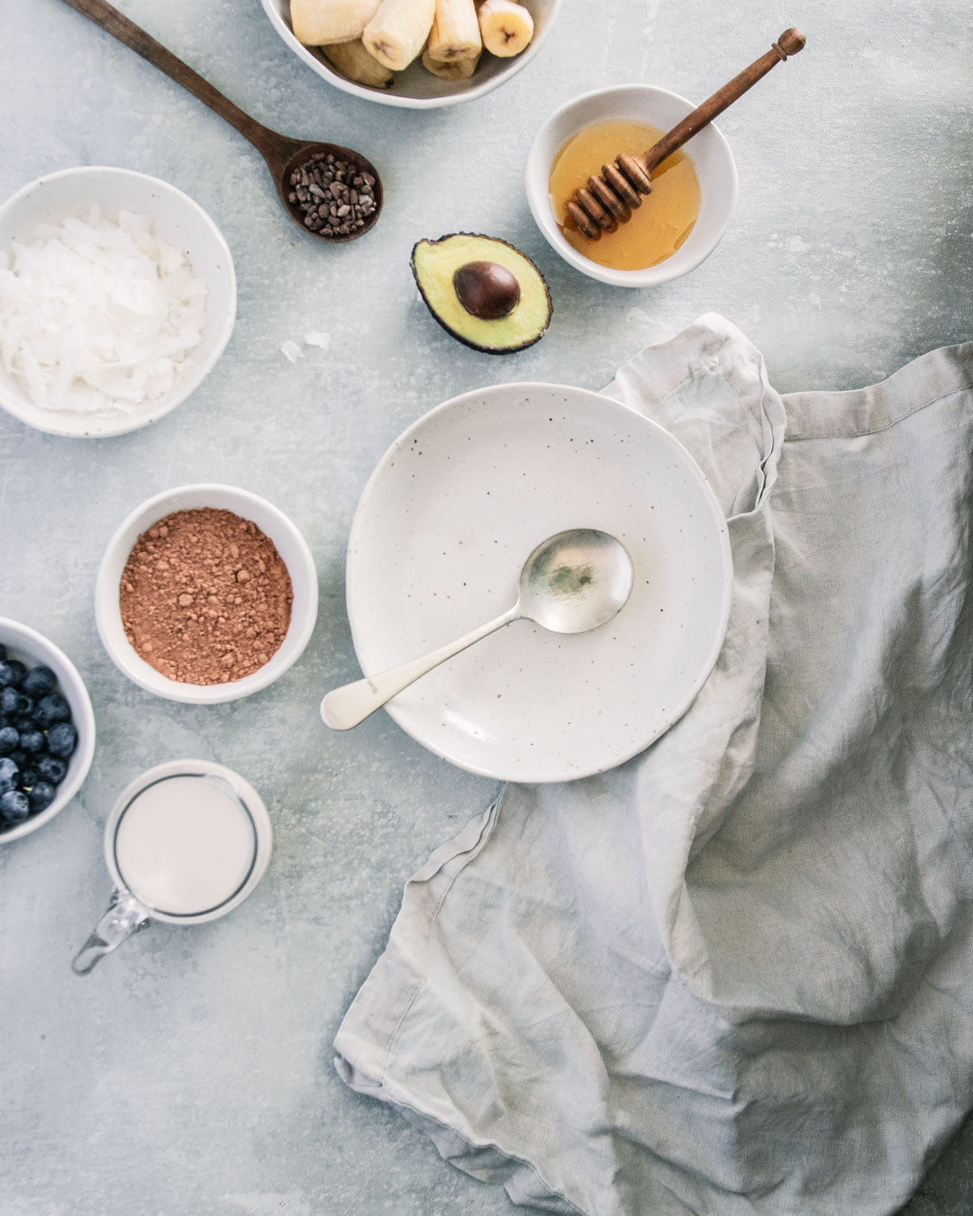 Flat lay of Winterwares ceramics containing the ingredients for a chocolate smoothie bowl