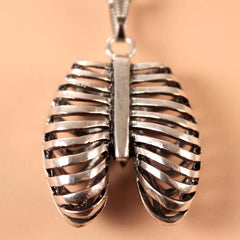 View Image of ribcage-necklace_R3ZQ5X3ZMGOK.jpg