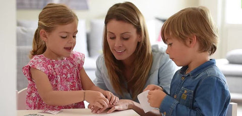 children playing with sticker book