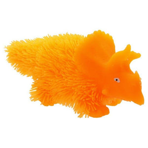 a close up of a orange stuffed animal