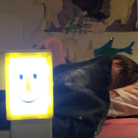 sleeping next to emoji night light