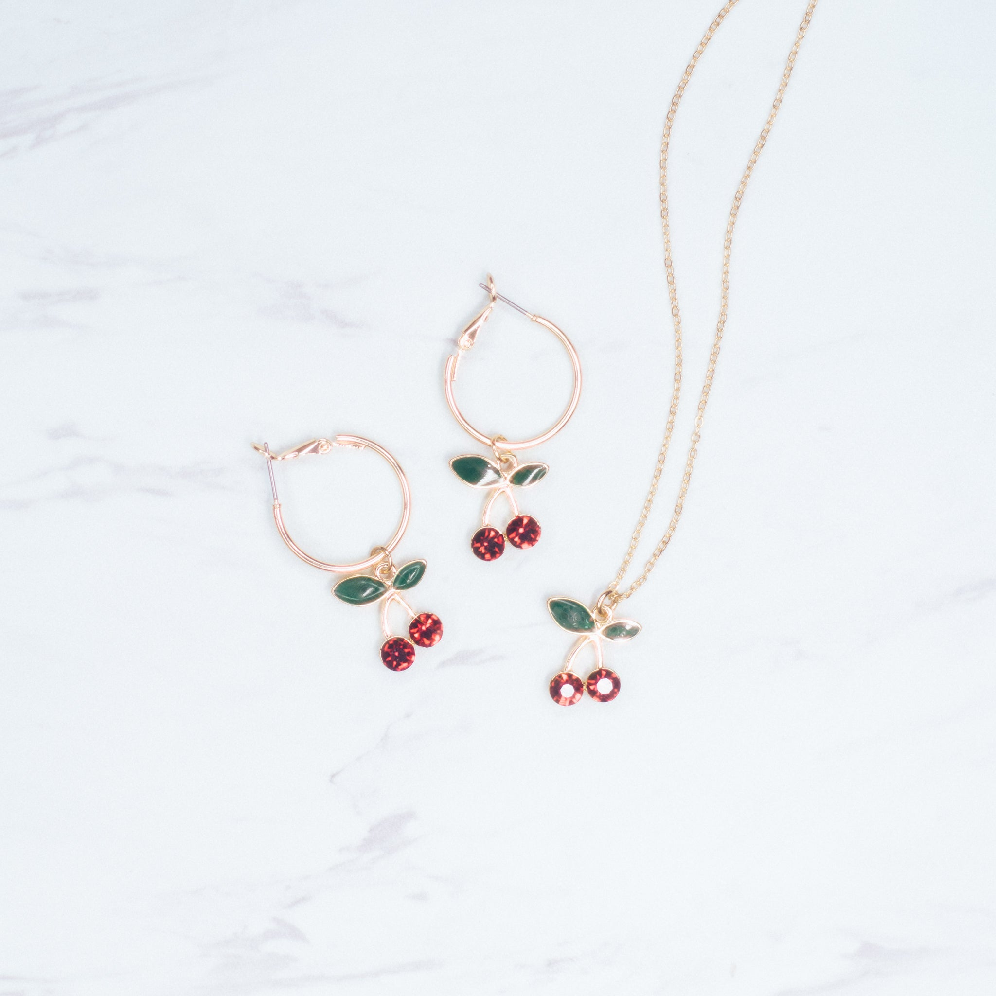 April adornment Earrings and cherry necklace