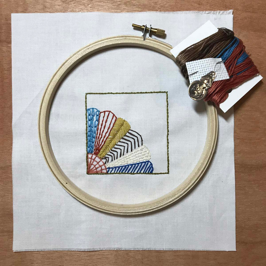 embroidery kit featuring fan quilt block design with hoop, needle and thread