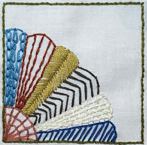 embroidered fan quilt block design in multiple colors