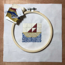 Load image into Gallery viewer, embroidery kit featuring sailboat quilt block design with hoop, needle and thread