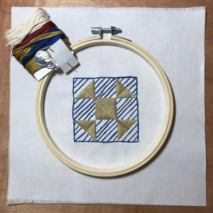 embroidery kit featuring shoofly quilt block design with hoop, needle and thread