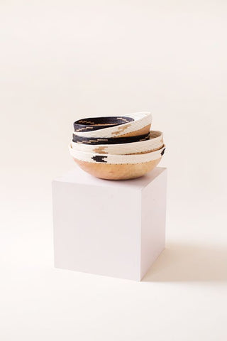 "Hand-carved jacaranda wood Copabu Bowl by Indego Africa. Hand carved jacaranda wood. Hand dyed sisal. Locally sourced natural fibers Measurements 7.5"" x 3.5"" Black, tea & natural wood. Available in Black and White. Spot Clean."