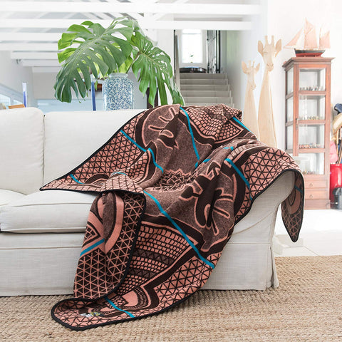 Salmon Kharetsa Spiral Aloe Basotho Heritage Blanket by Aranda Textiles. Handmade in South Africa. The Basotho heritage blankets are made using a vertical manufacturing process. The 50% wool and 50% Draylon blended yarn is spun in-house, then woven using state-of-the-art jacquard weave technology into the finest quality Basotho blankets. Color pink.