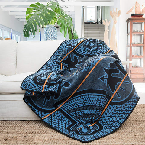 Peacock Kharetsa Spiral Aloe Basotho Heritage Blanket by Aranda Textiles. Handmade in South Africa. The Basotho heritage blankets are made using a vertical manufacturing process. The 50% wool and 50% Draylon blended yarn is spun in-house, then woven using state-of-the-art jacquard weave technology into the finest quality Basotho blankets. Color blue.