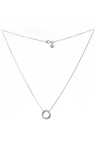 Article 22 Spring 2018 Virtuous Circle Necklace. Simple, elegant pendant choker necklace with dainty adjustable length chain and hand cast circle talisman charm. 1 inch charm. Adjustable 16 to 17 inch chain. Colors silver, rose gold. Sterling silver, rose gold filigre. Adjustable size.